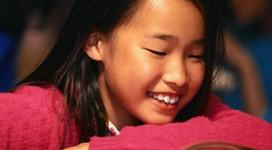 Girl Reading in School